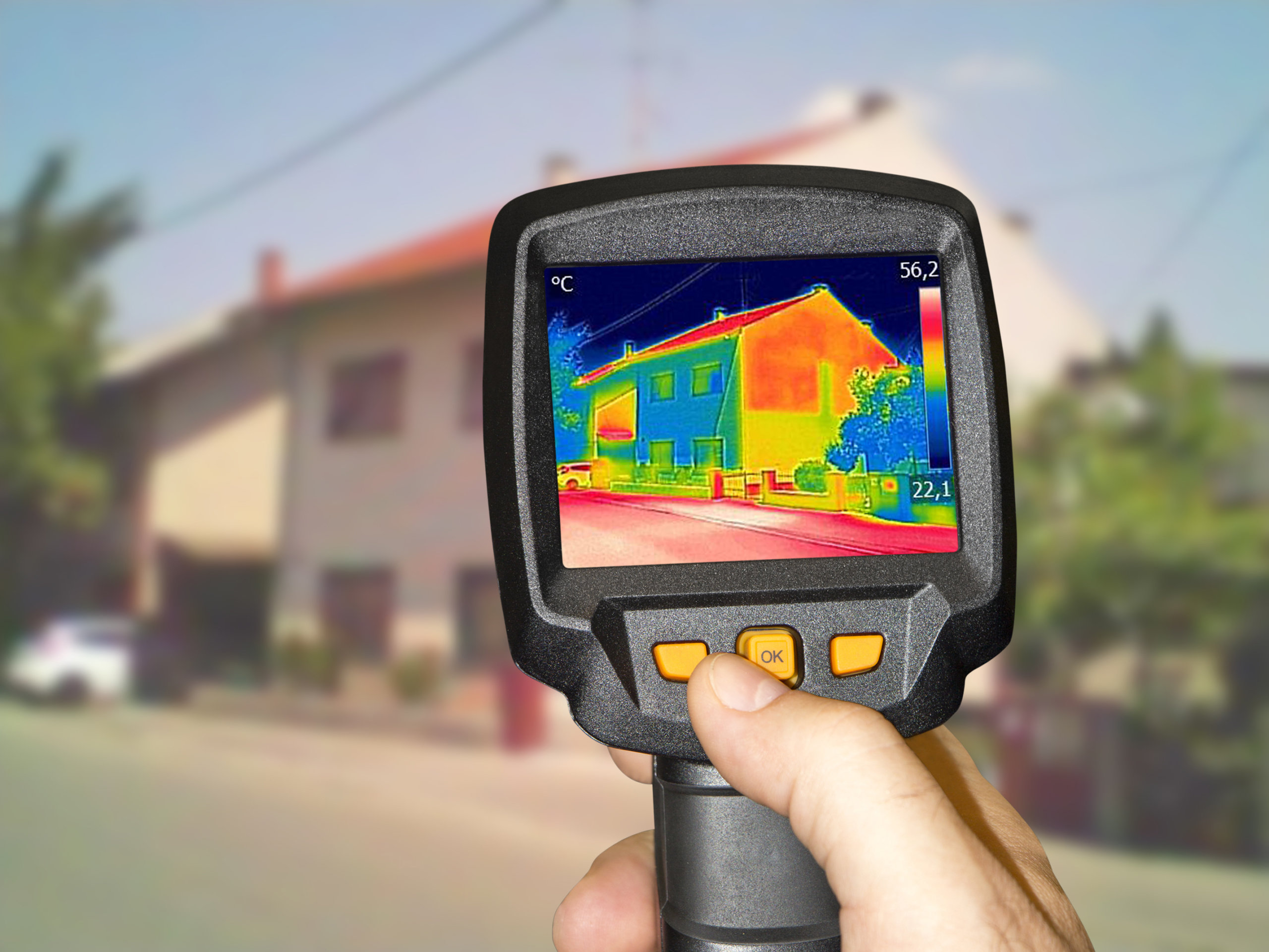 A home being inspected through a thermographic imaging camera